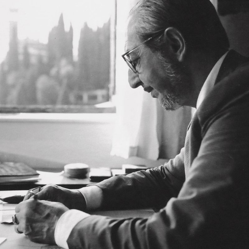 Portrait of Italian architect and designer Carlo Scarpa on his desk working