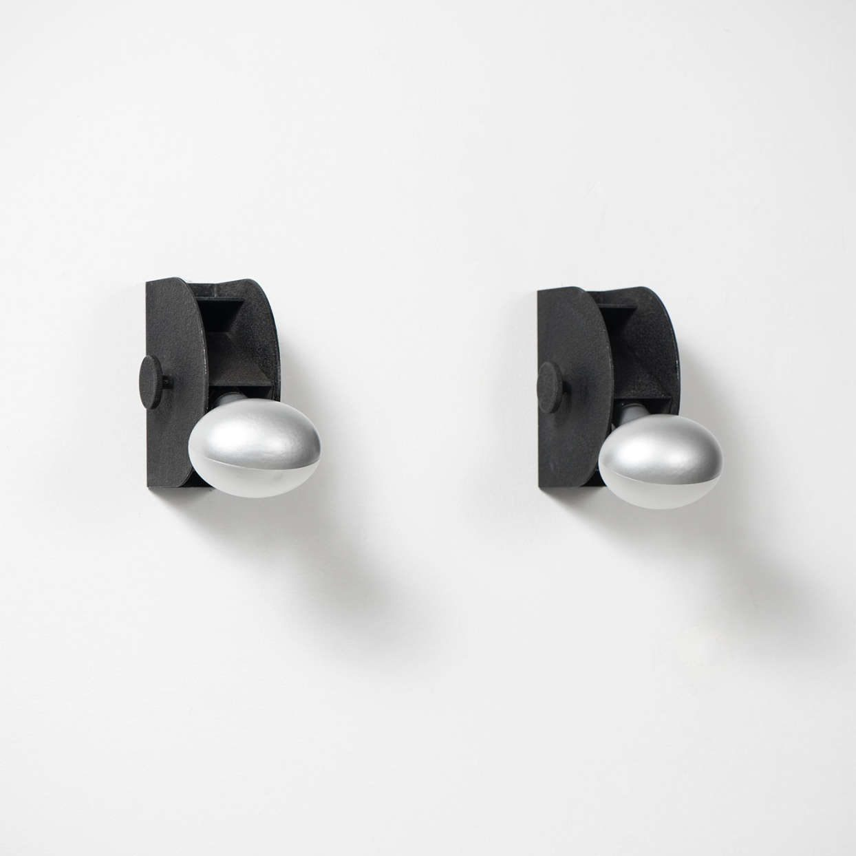 Italian designer Gino Sarfatti black sconces manufactured by Arteluce
