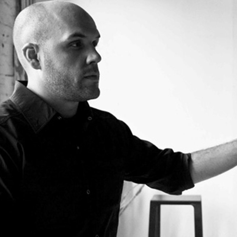 Photograph of American designer Jonathan Nesci in his studio wearing a black shirt