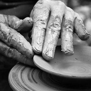 Italian artist Lucio Fontana making a ceramic