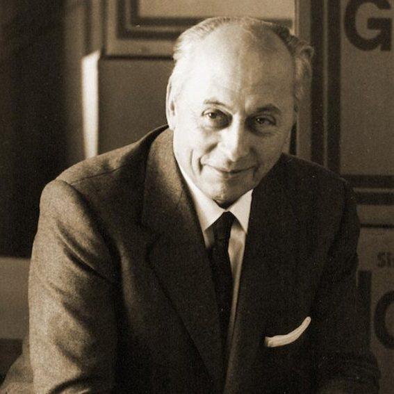 Portrait of Italian architect and designer Osvaldo Borsani wearing a suit and smiling