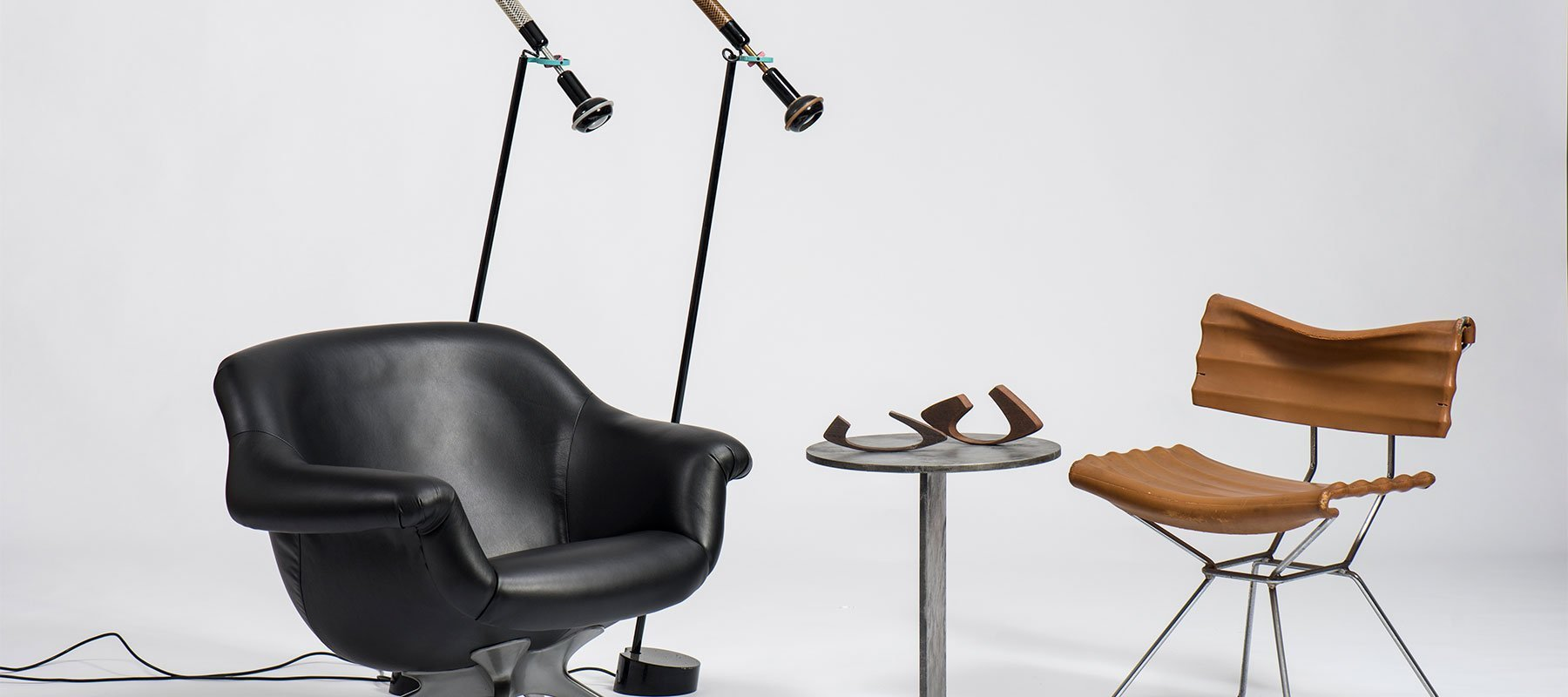 Black leather Angelo Mangiarotti chair with two Grip Floor lamps, and a Mangiarotti Tensio chair