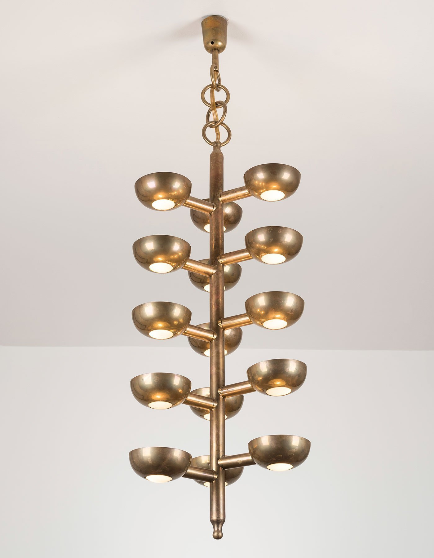 Italian designer Gino Sarfatti brass ceiling light model 2049 manufactured by Arteluce (portrait with lights on) at design and furniture gallery Casati Gallery