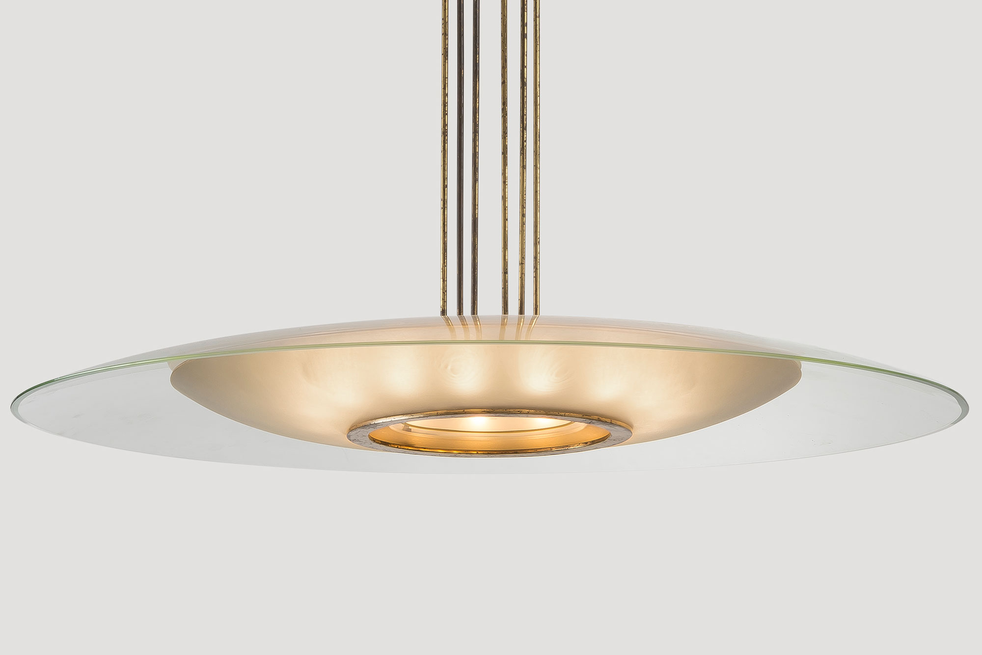 Large glass disk Fontana arte chandelier with lights on at Italian design and furniture gallery Casati Gallery