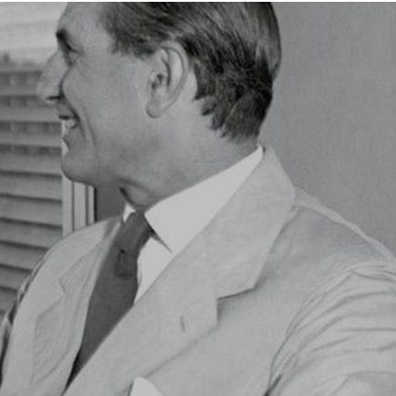 Profile picture of Italian architect and designer Ignazio Gardella wearing a light suit