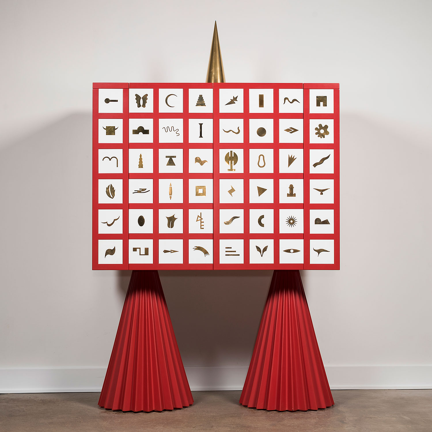 Red and white Mania cabinet with good accents, design by Alessandro Mendini