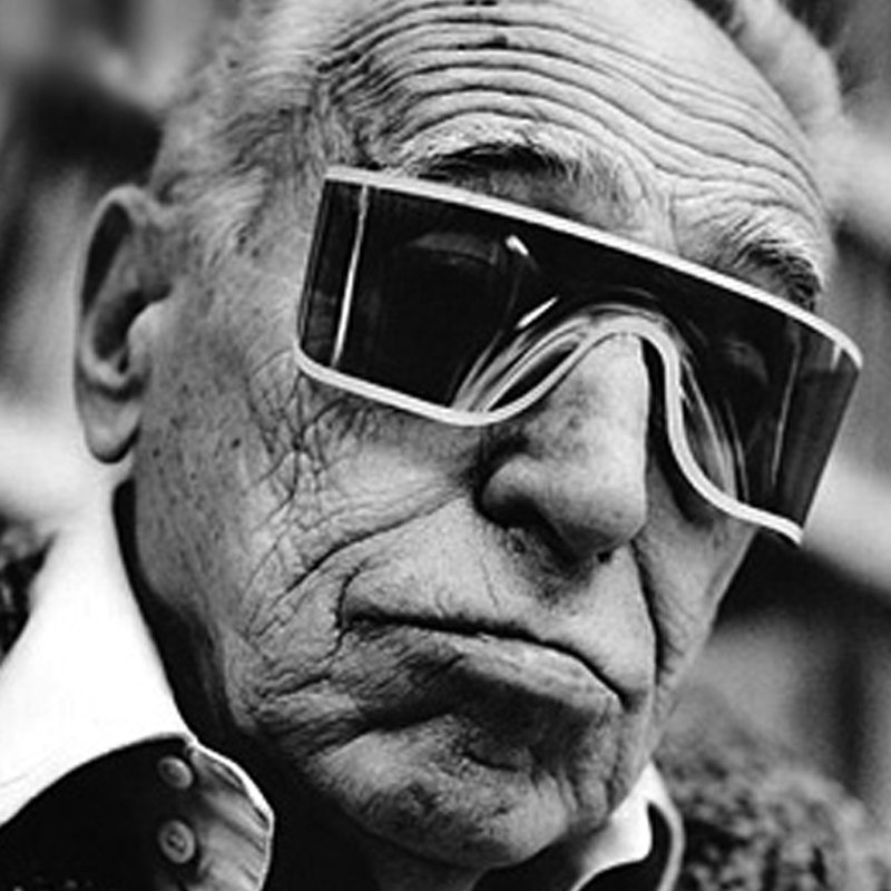 Achille Castiglioni wearing glasses
