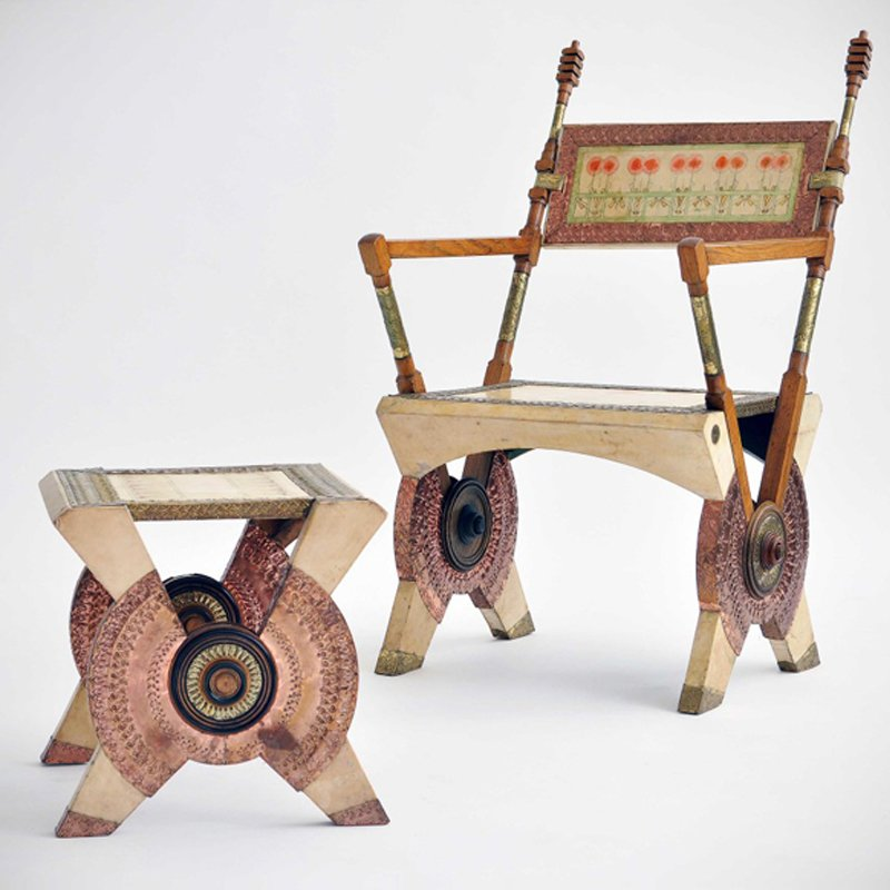 Chair and ottoman in wood covered in white leather designed by Italian designer Carlo Bugatti