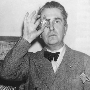 Portrait of Italian modernist and art deco designer Pietro Chiesa holding a star in front of his eye and wearing a bow tie