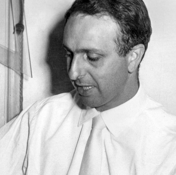 Portrait of Italian designer Victoriano Viganò wearing a white shirt and a white tie while he was young
