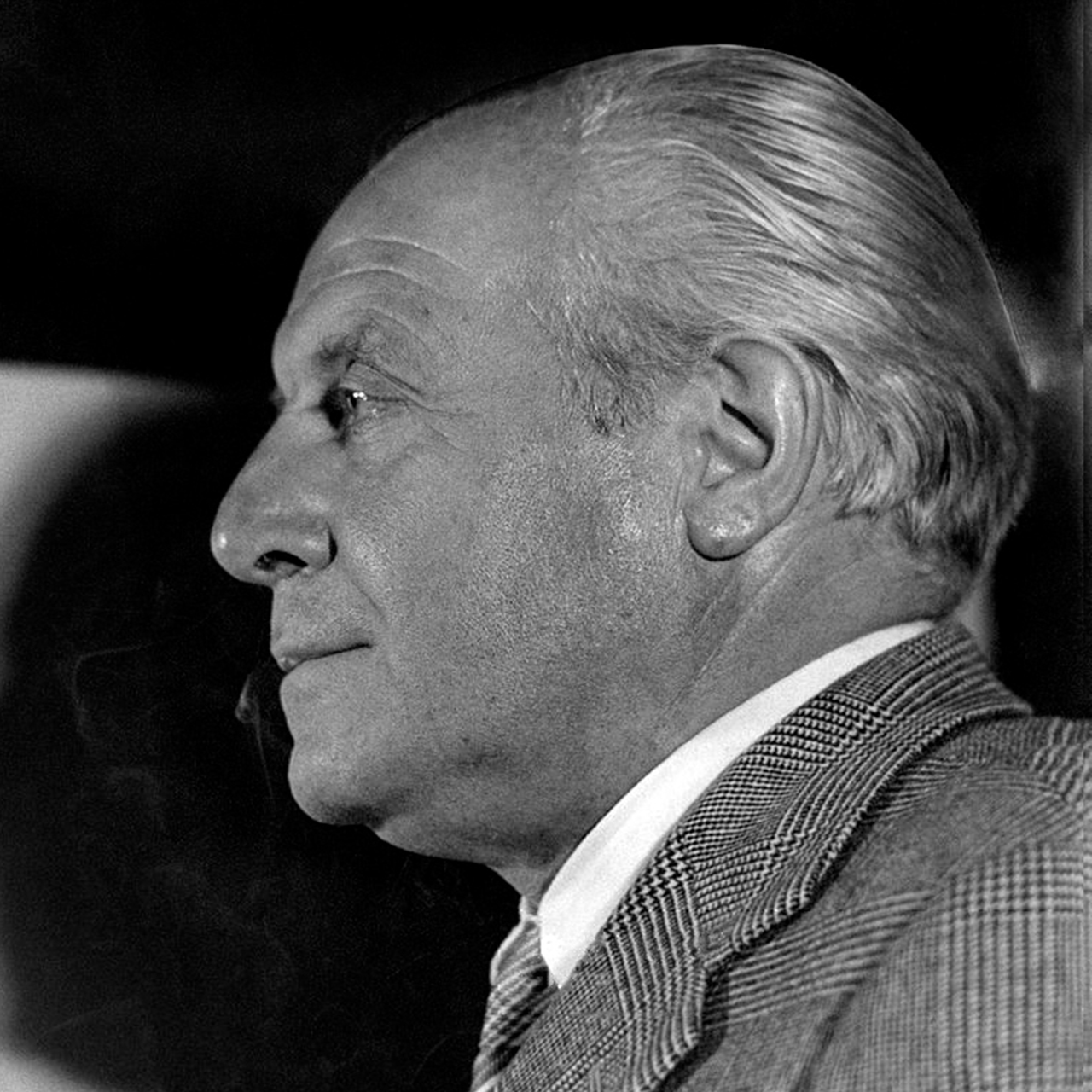 Portrait of Italian architect and designer Gio Ponti with gray checkered suit