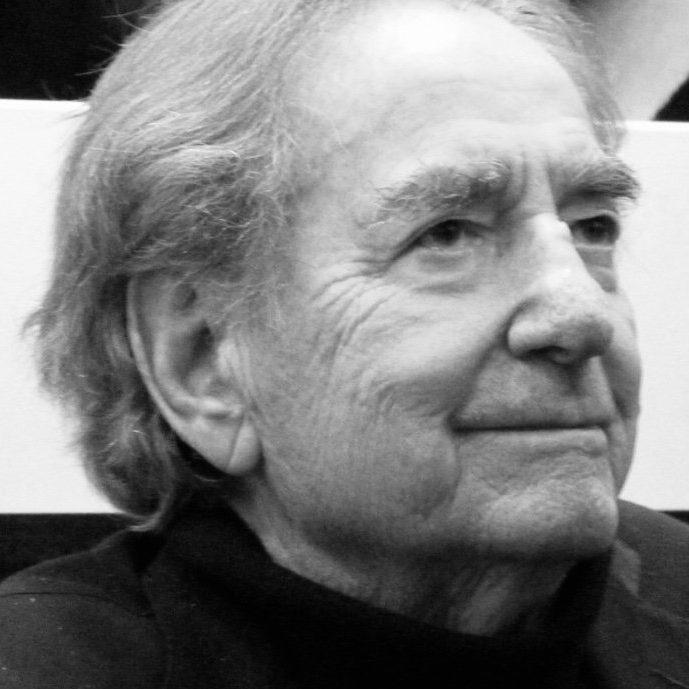 Profile portrait of Italian designer and photographer Willi Rizzo smiling