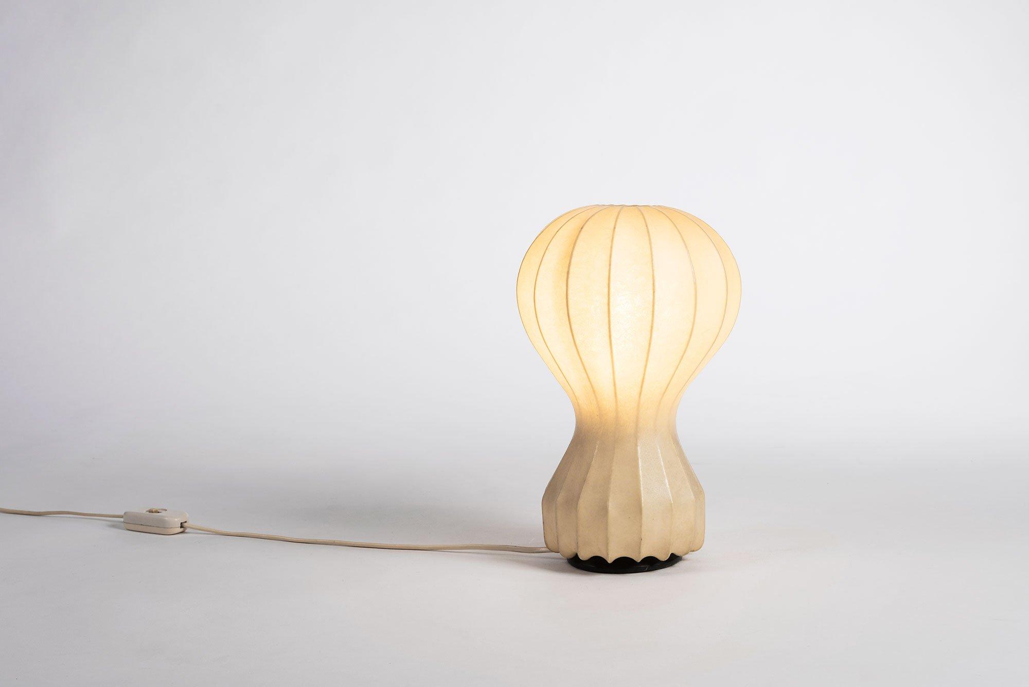 Turned on Gatto table lamp designed by Achille Castiglioni