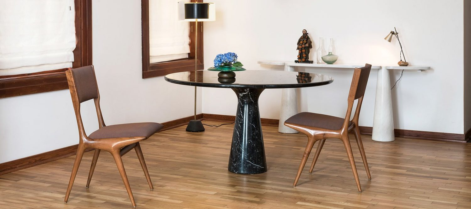 Chairs by Carlo de Carli, black marble table and white marble console by Angelo Mangiarotti, floor lamp by Gino Sarfatti, Sasso table lamp by Luigi Caccia Dominioni, glass vase by Fontana Arte.