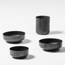 Four copper vases by Lorenzo Burchiellaro