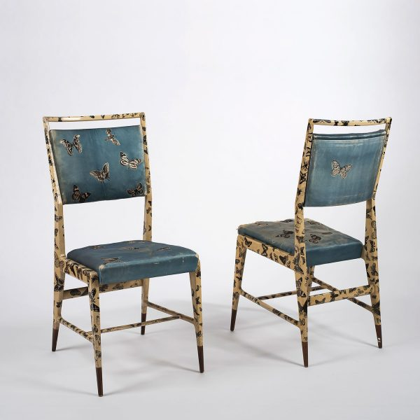 Pair of chairs designed by Gio Ponti and Piero Fornasetti with butterfly motives in the fabric and painted on the wood