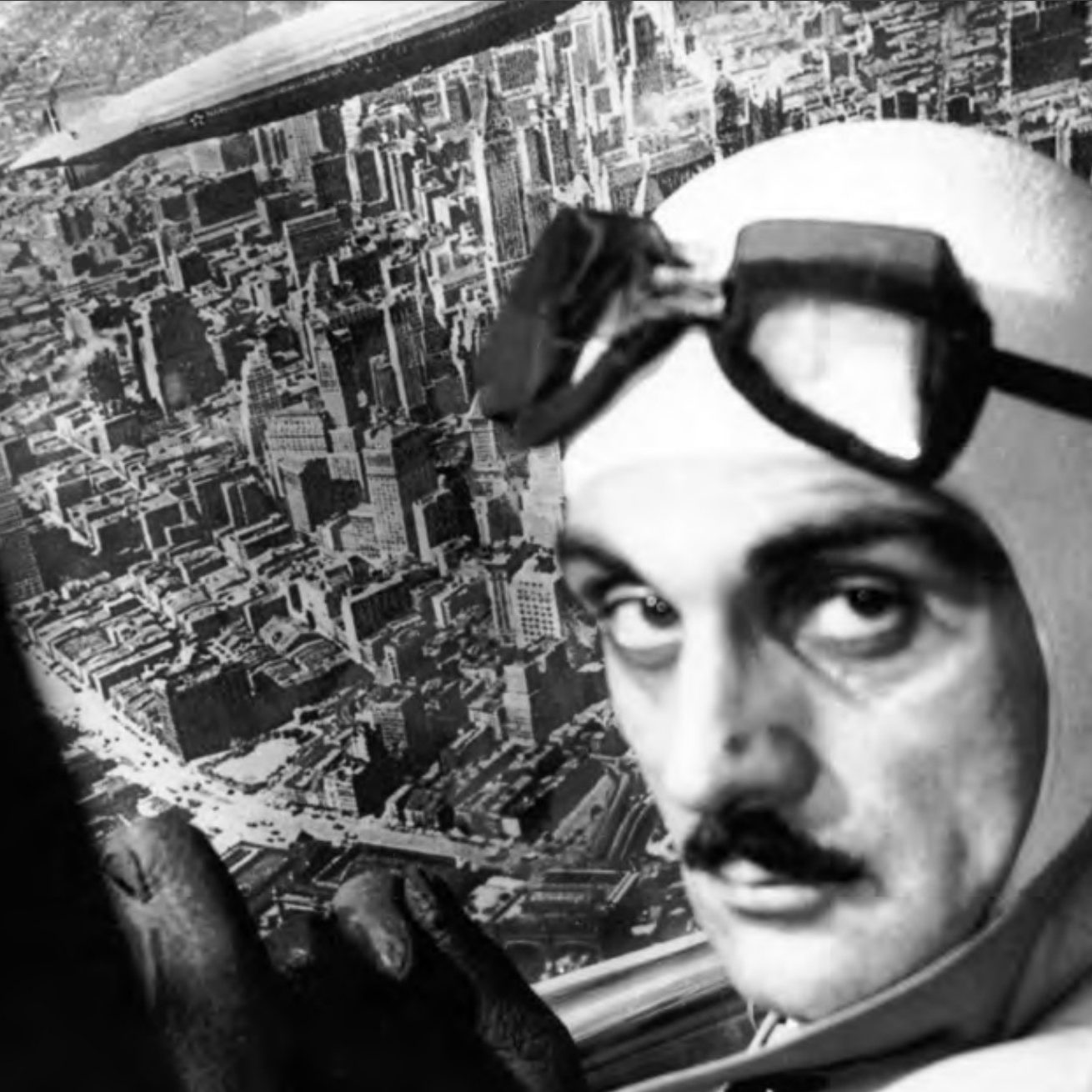 Portrait of Carlo Mollino flying on a place and with goggles on his head