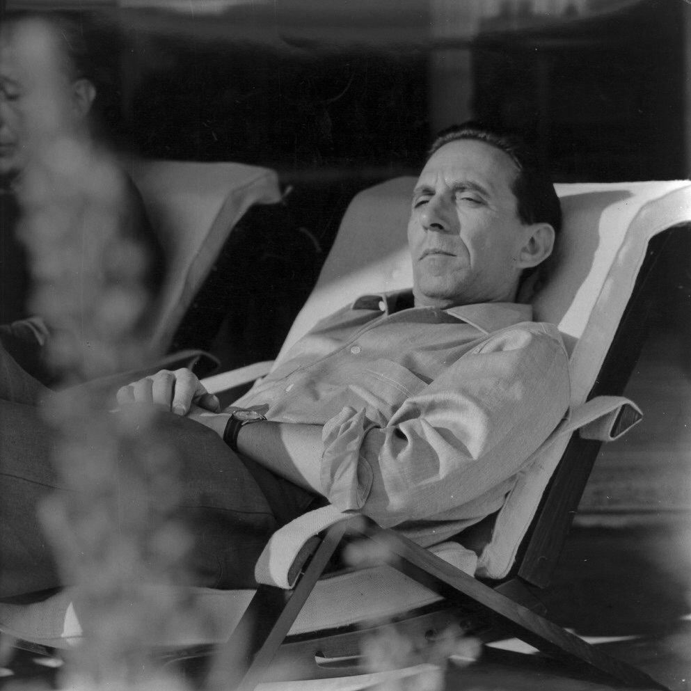 Portrait of Ico Parisi on a garden lounge chair taken in 1960