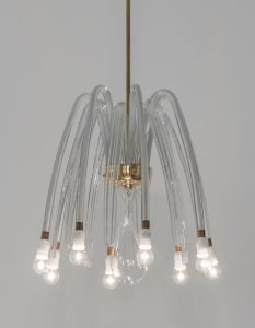Carlo Scarpa eight arm glass chandelier made by Venini with lights on at Italian design and furniture gallery Casati Gallery