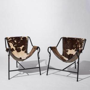 Two Lina Bo Bardi Tripod chairs square picture