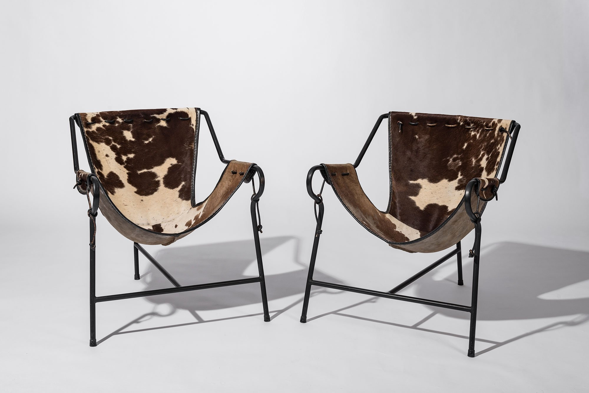 Tow Lina Bo Bardi Tripod chairs at Casati Gallery