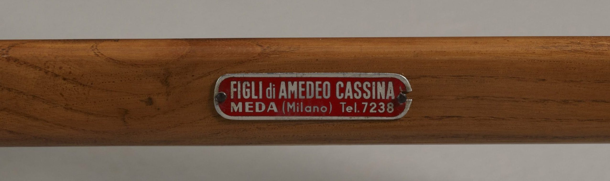Metal label of the Superleggera chair by furniture maker Figli di Amadeo Cassina