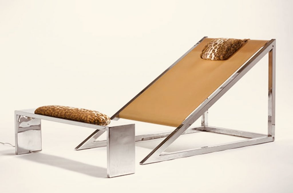 Radical design Mies chair and ottoman made out of rubber, cow hide and a chromed frame by Archizoom