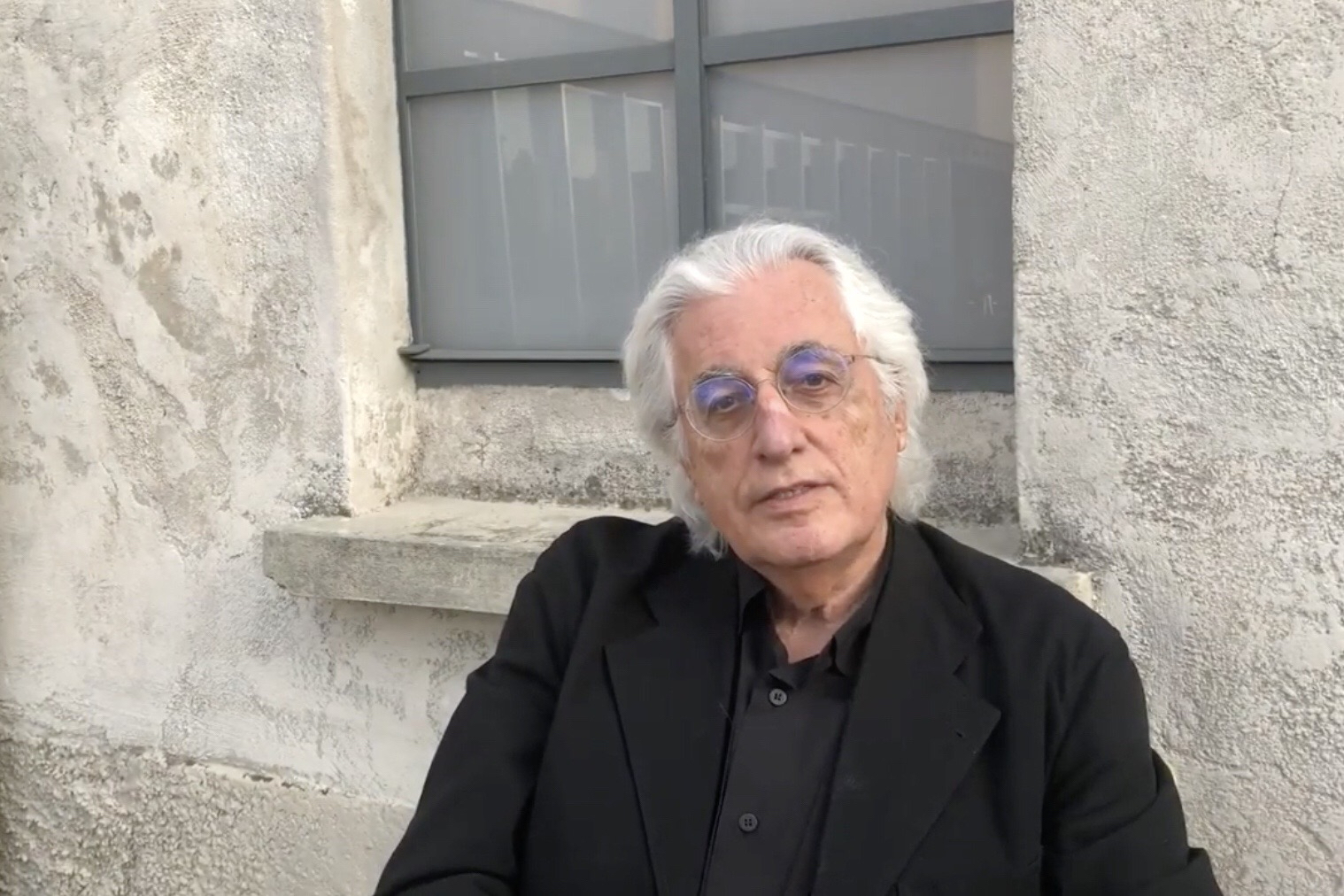 Italian art critic and curator Germano Celant interviewed outside Prada Foundation