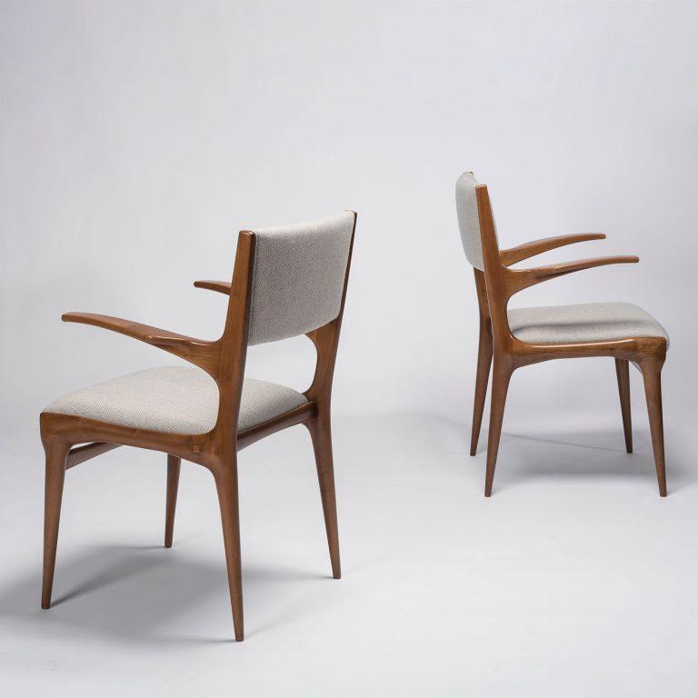 Two Carlo De Carli model 585 chairs