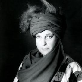 Portrait of Italian artist, architect, and designer Nanda Vigo wearing a head scarf