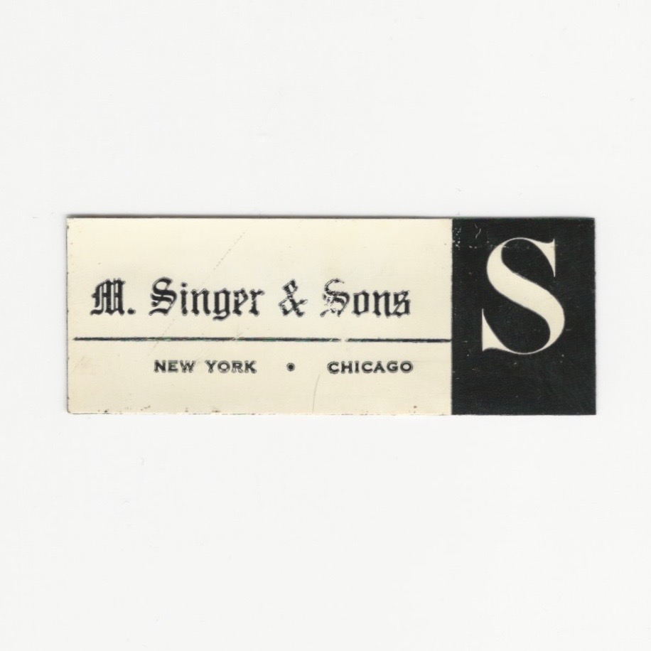 Vintage label of furniture maker Singer & Sons with white background and the workds M. Singer & Sons New York Chicago