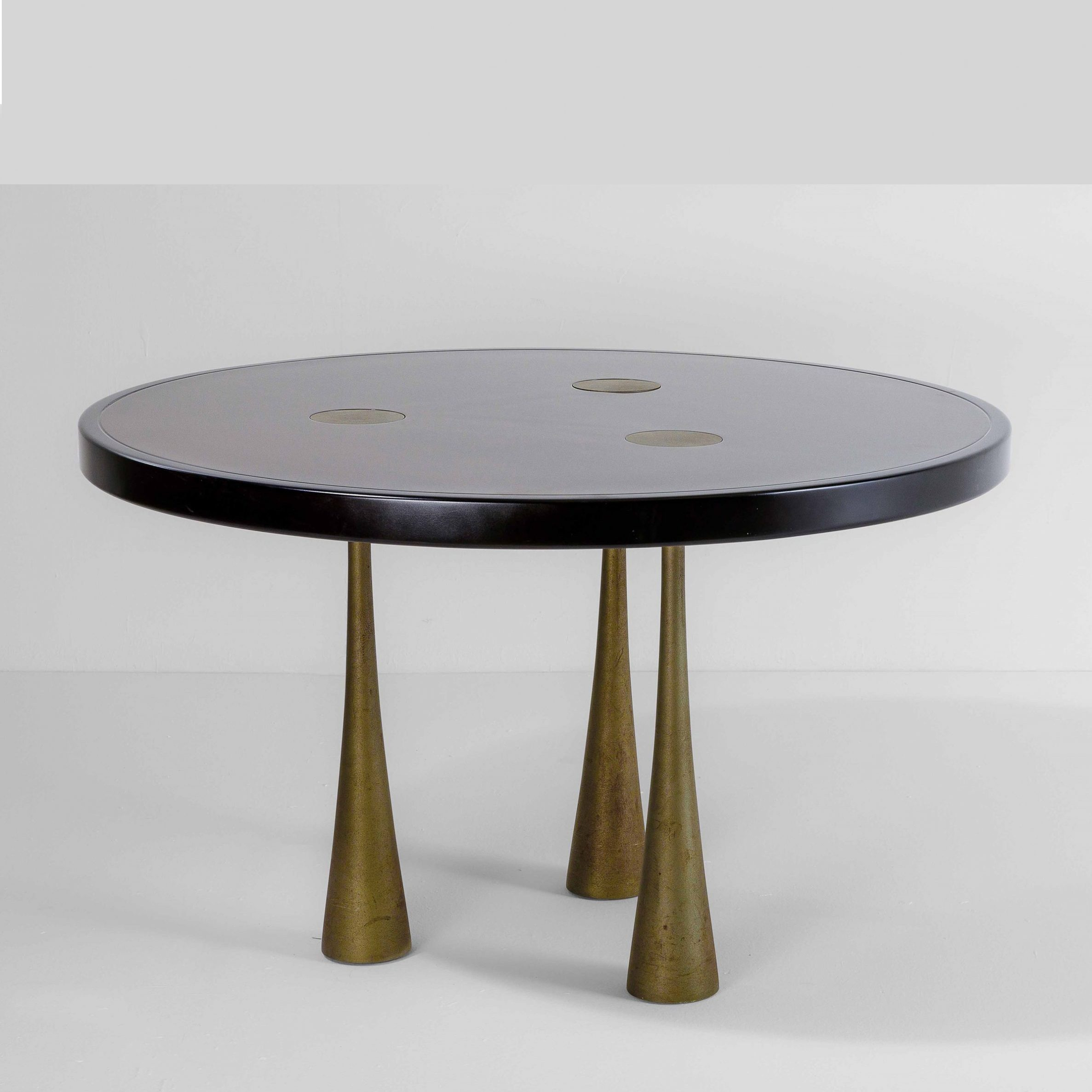 Andelo Mangiarotti |                                  Wood table with three cast iron bases